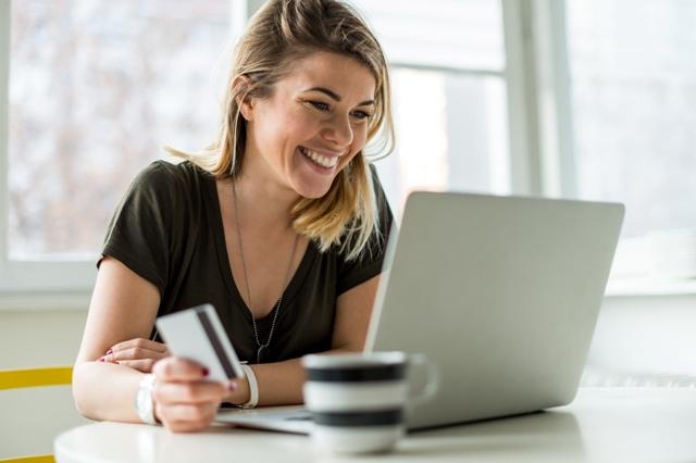 Smiling woman buying online.