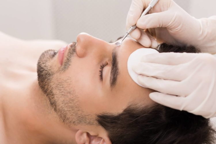 Man undergoing dermatological treatment.