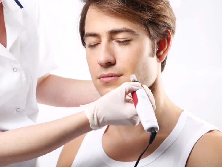 Man receiving Microneedling treatment.